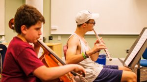 Campers playing the flute and cello