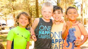 Young campers smiling together