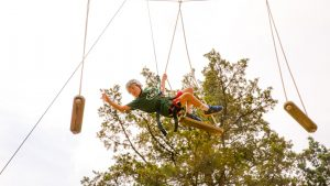 Camper doing the ropes course